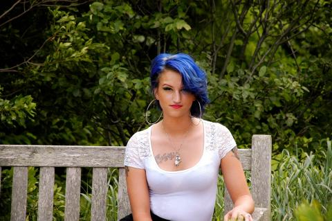 Brightly shimmering blue hair flirting with the breeze. Instagram @beautybyrengle